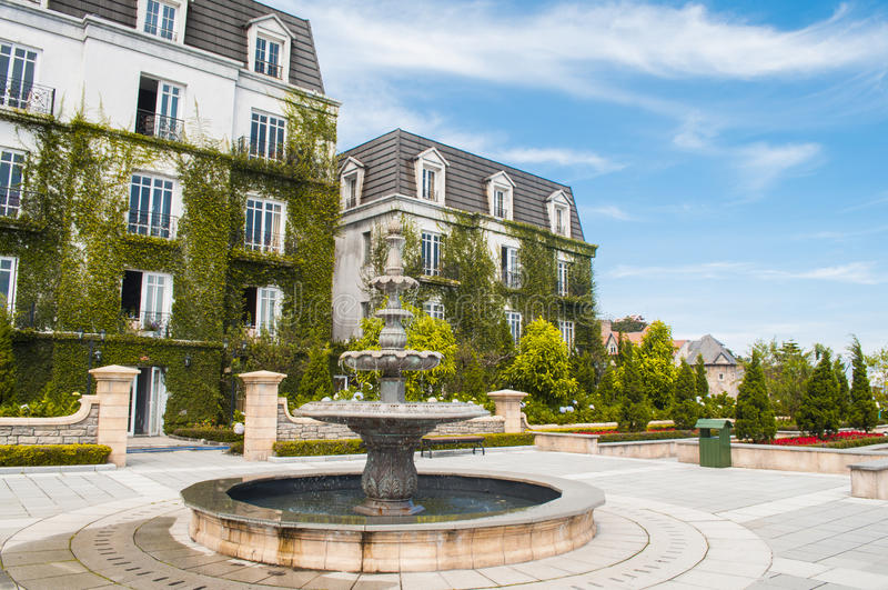 Picturesque garden near the hotel. Picturesque garden with a fountain near the hotel stock images