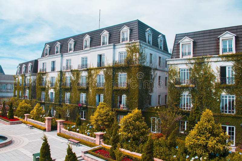 Picturesque garden near the hotel. Picturesque garden with a fountain near the hotel stock photos