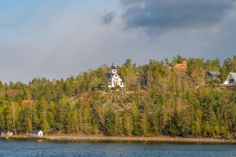 Picturesque Grävlingsberg Villa on hilltop. The special tower belongs to one of the Stockholm archipelago fairway`s landmarks stock photography