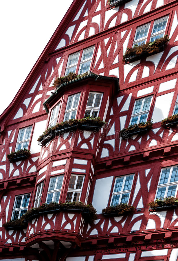 Picturesque half-timbered house with bay windows in Miltenberg, Germany. Picturesque historic half-timbered house with bay windows in the medieval town of royalty free stock photo