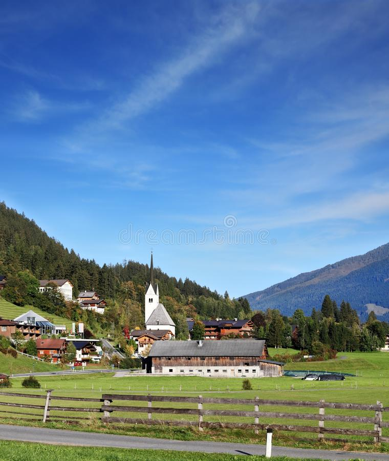 Picturesque houses in green valley stock images