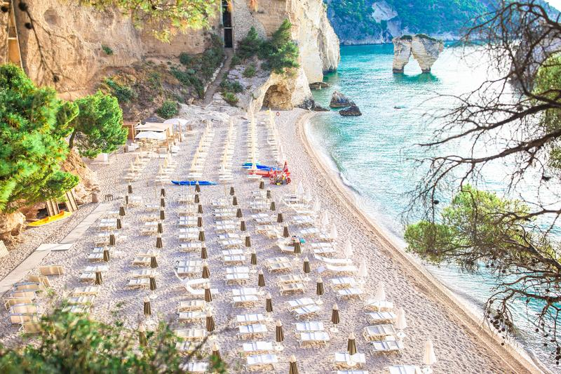Mattinata Faraglioni stacks and beach coast of Mergoli, Vieste Gargano, Apulia, Italy. royalty free stock images