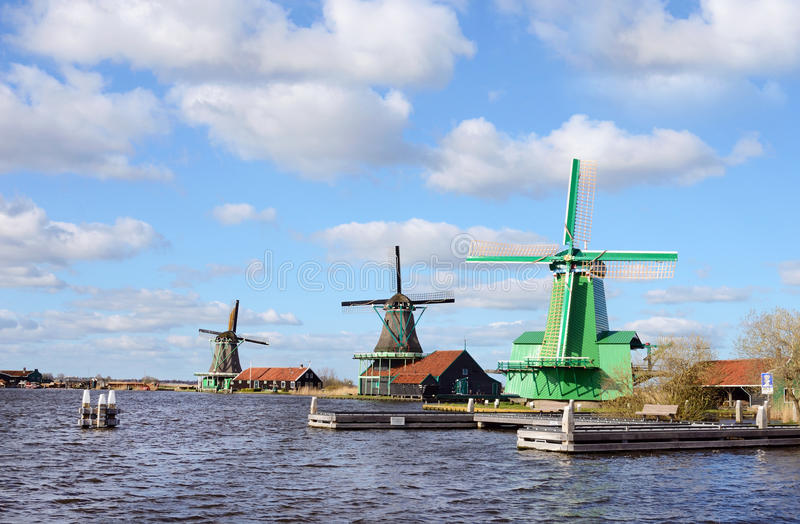 The picturesque landscape with aerial mill on the channel in Zaanse Schans, Holland on a background cloudy sky stock photo