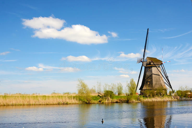 The picturesque landscape with aerial mills on the channel in Kinderdiyk, Netherlands stock photography