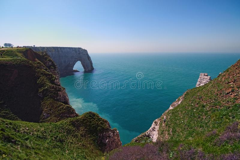 Picturesque landscape on the cliff of Etretat. la Manneporte natural rock arch wonder, cliff and beach. stock images