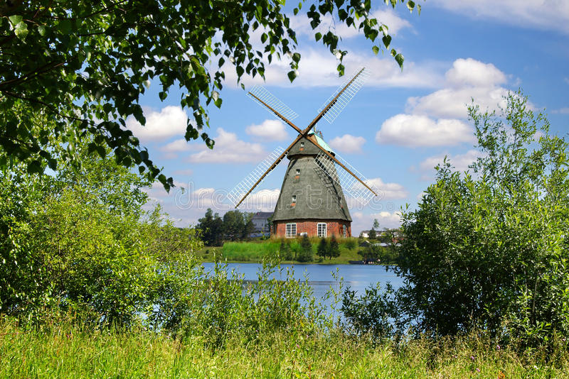 Picturesque Landscape With Old Mill And Lake Stock Photo