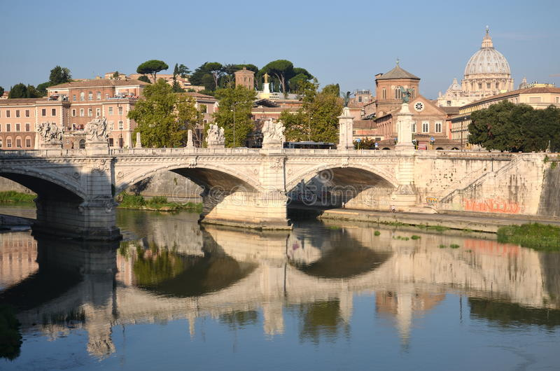 Picturesque landscape of St. Peters Basilica over Tiber in Rome, Italy royalty free stock image