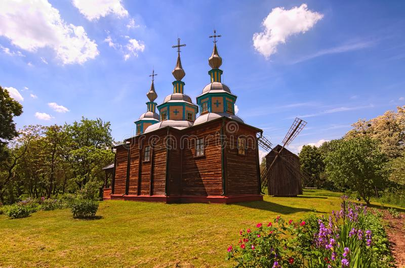 Picturesque landscape view of ancient wooden church at sunny spring day.  Pereyaslav-Khmelnitsky Museum of Folk Architecture royalty free stock photos