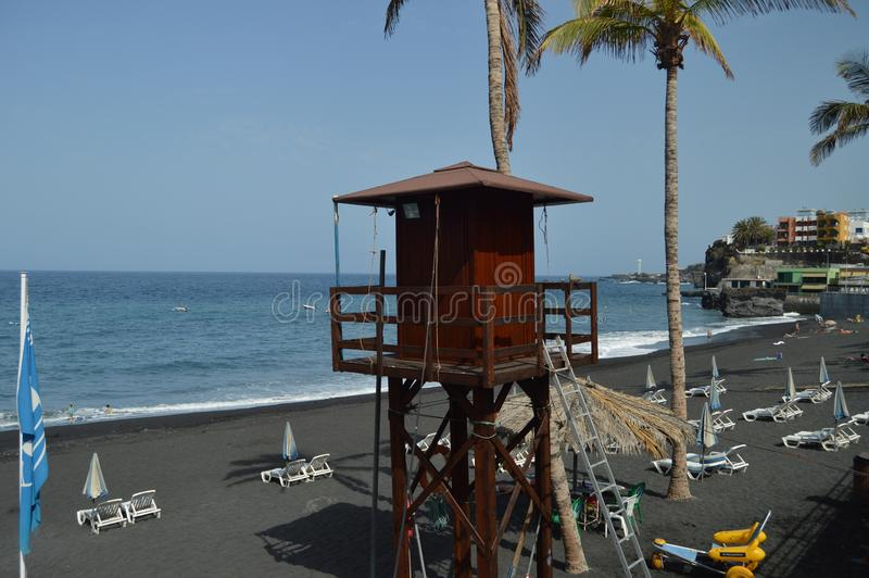 Picturesque Lifeguard Post On The Long Black Volcanic Sand Beach In Puerto Naos In The City Of Los Llanos. Travel, Nature,. Landscapes.11 July 2015. Los LLanos royalty free stock photo