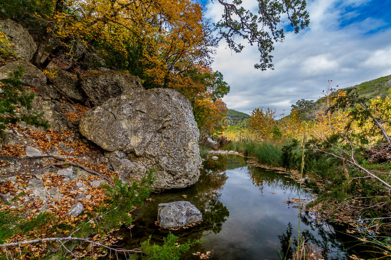 Picturesque Lost Maples Creek, TX. A Picturesque Scene with Granite Boulders and Beautiful Fall Foliage on a Tranquil Babbling Brook at Lost Maples State Park stock photos