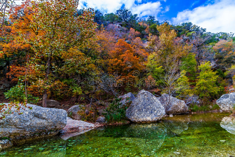 Picturesque Lost Maples Creek, TX. A Picturesque Scene with Granite Boulders and Beautiful Fall Foliage on a Tranquil Babbling Brook at Lost Maples State Park royalty free stock photos