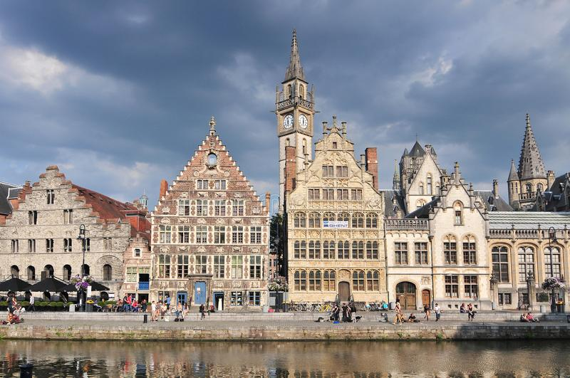 Picturesque medieval buildings overlooking the Graslei harbor on Leie river in Ghent town Belgium Europe.  stock photo