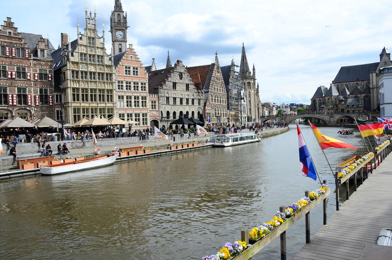 Picturesque medieval buildings overlooking the Graslei harbor on Leie river in Ghent town, Belgium. Gent, Belgium - May 16, 2016: Picturesque medieval buildings stock photos