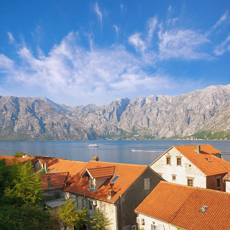 Picturesque Mediterranean landscape. Montenegro, view of Bay of Kotor and red roofs of Prcanj town stock photos