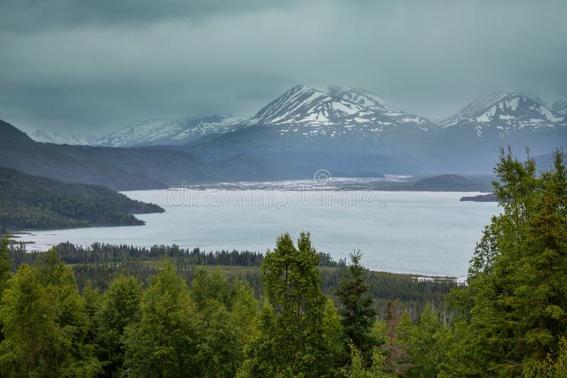 Mountains in Alaska. Picturesque Mountains of Alaska in summer. Snow covered massifs, glaciers and rocky peaks royalty free stock photos