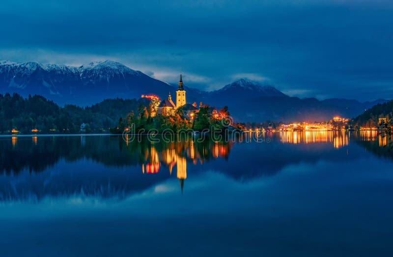 Picturesque night scenery at Bled lake, Slovenien royaltyfri bild