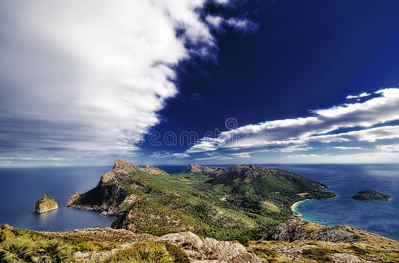 Picturesque ocean coastline. Scenic view of picturesque rocky ocean coastline under blue sky and cloudscape, Majorca, Balearic, Islands, Spain royalty free stock image
