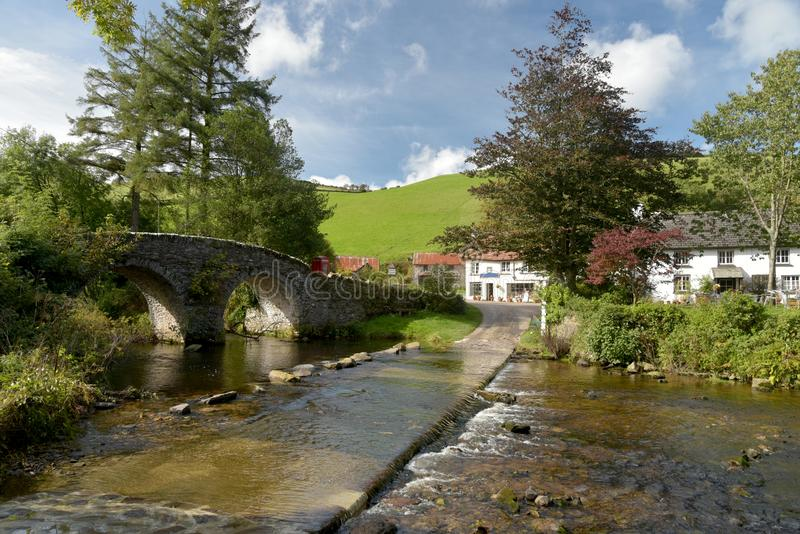 Packhorse bridge and ford at Malmsmead, Exmoor, North Devon. Picturesque packhorse bridge and ford through Badgworthy Water at Malmsmead, Exmoor, North Devon royalty free stock photography