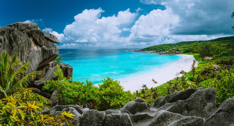 Picturesque panoramic shot of Grand Anse, La Digue island, Seychelles. Huge granite rock formation, bright white sand royalty free stock photo