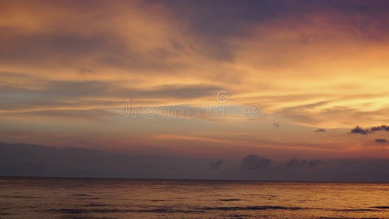 Picturesque Pink sunset on lake beach sea sand beautiful colors in the sky clouds.  royalty free stock photography