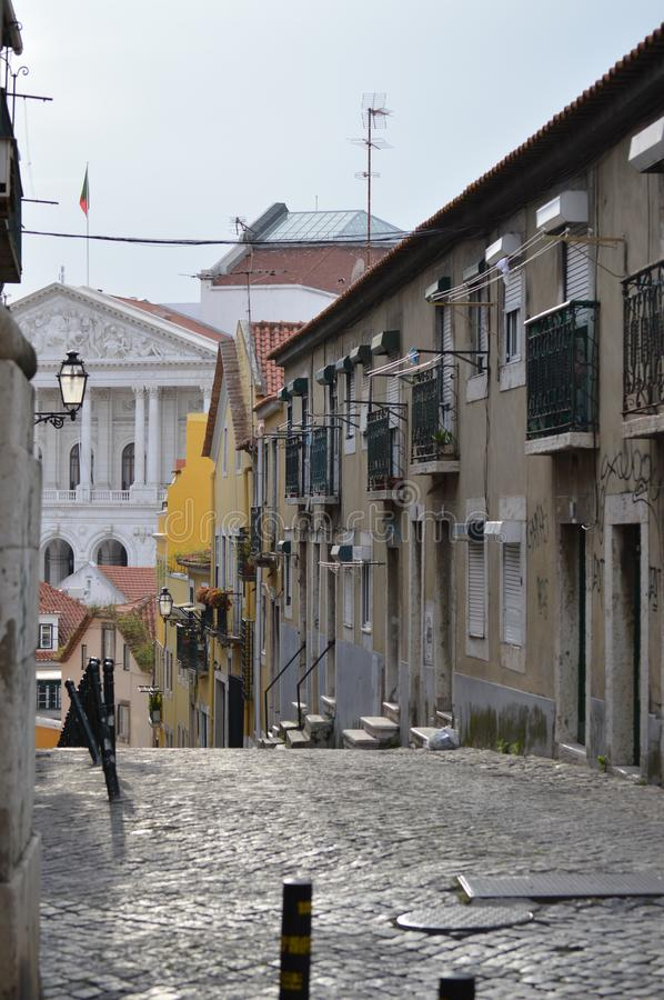 Picturesque Pixeira Crossing Scene In The High Bohemian Quarter With Views Of The Palace Of The Assembly Of The Republic In Lisbon stock photography