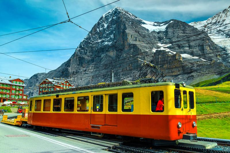 Picturesque place with mountains and old tourist train, Grindelwald, Switzerland royalty free stock photo