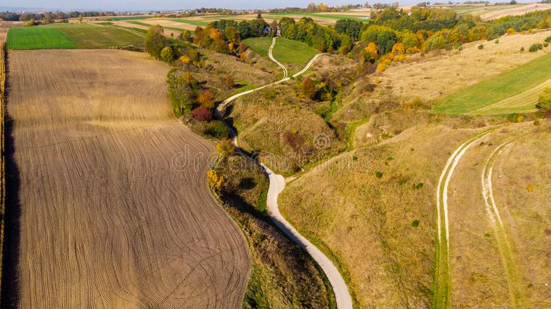 Picturesque Polish Countryside and Farm Field at Fall. Aerial Drone View. Ponidzie, agricultural, agriculture, autumn, colorful, crop, cultivated, drive stock images