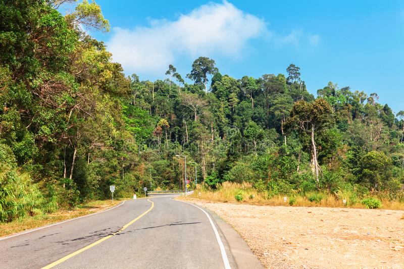 Picturesque road in mountains of National park Bokor leading to Abandoned hotel Bokor Palace in Ghost town Hill station near Kampo. T. Cambodia in the clouds stock photo