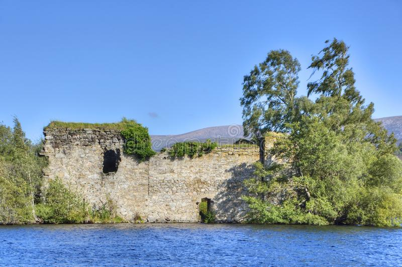 Picturesque Ruin of Castle on Island of Loch in the Scottish Highlands. View, on a sunny day in August, of the ruinous castle on the small island on Loch an stock photo