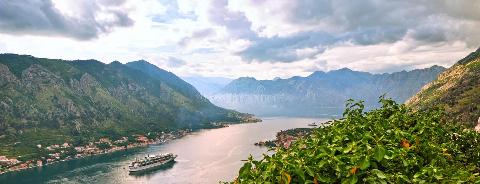 Picturesque sea view of Boka Kotorska, Montenegro, Kotor old town. Shoot from air, from mountain fortification, wide angle, sunset.  royalty free stock images
