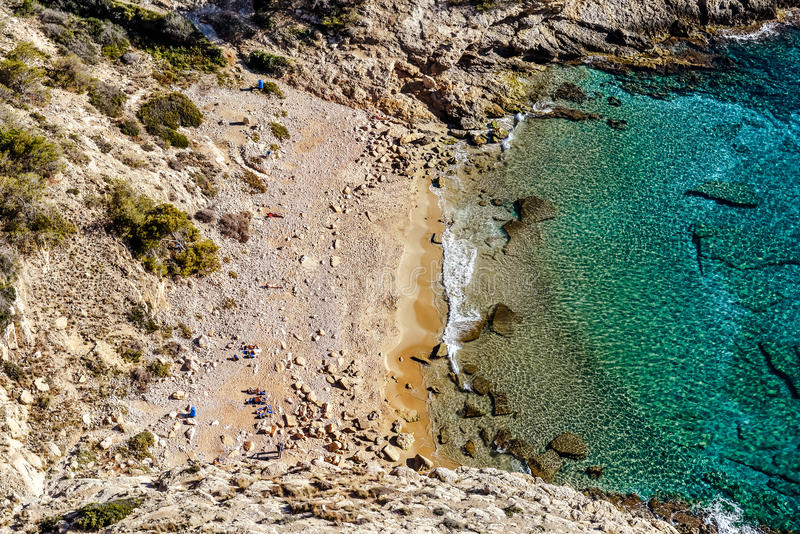 Picturesque small cove and lagoon. Of Cala Tío Ximo Beach in Benidorm city, view from the top. Cala Tío Ximo Beach is a popular destination for nudists royalty free stock photo