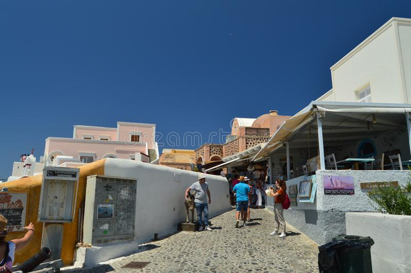 Picturesque Souvenir Shops On The Beautiful Main Street Of Oia On The Island Of Santorini. Architecture, landscapes, travel, cruis. Es. July 7, 2018. Island of royalty free stock photography