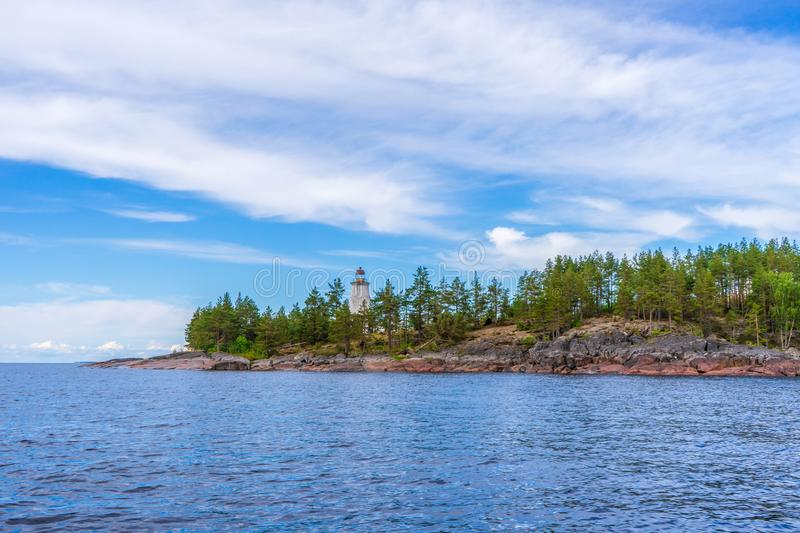 Picturesque summer landscape with northern lake coastline in cloudy day. Travelling and discovering distant places of Earth. View royalty free stock photo