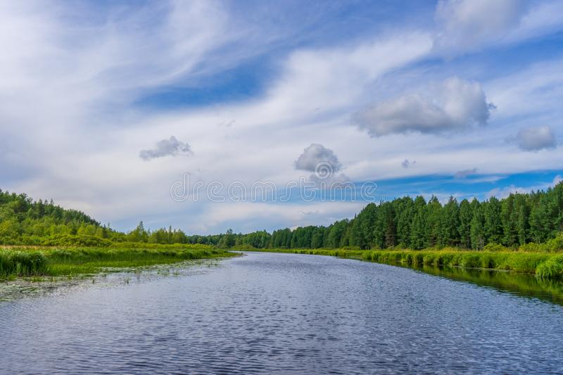 Picturesque summer landscape with northern river and forest in summer cloudy day. Travelling and discovering distant places of stock photography