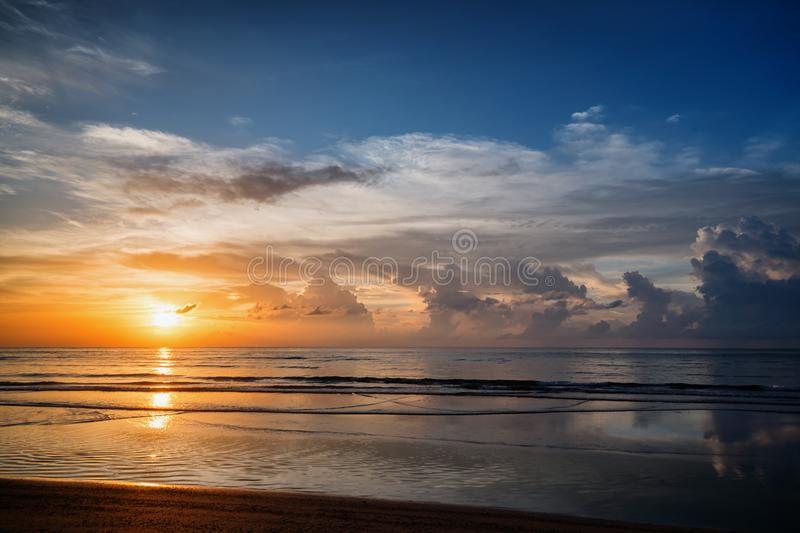 Picturesque sunset over a calm ocean. Phuket, Thailand stock images