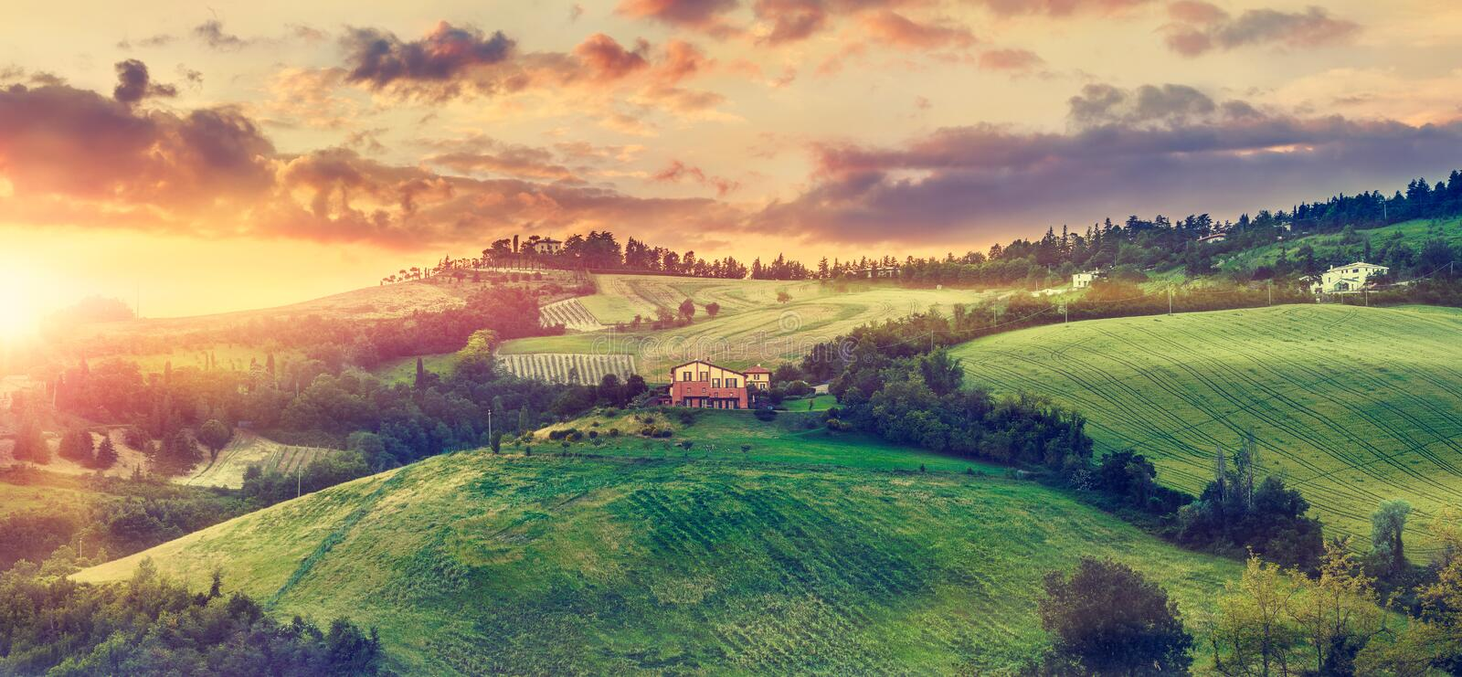 Picturesque sunset over green hills sunshine Italy. Dramatic sky cloud panorama landscape. Bologna. Tuscany stock photos