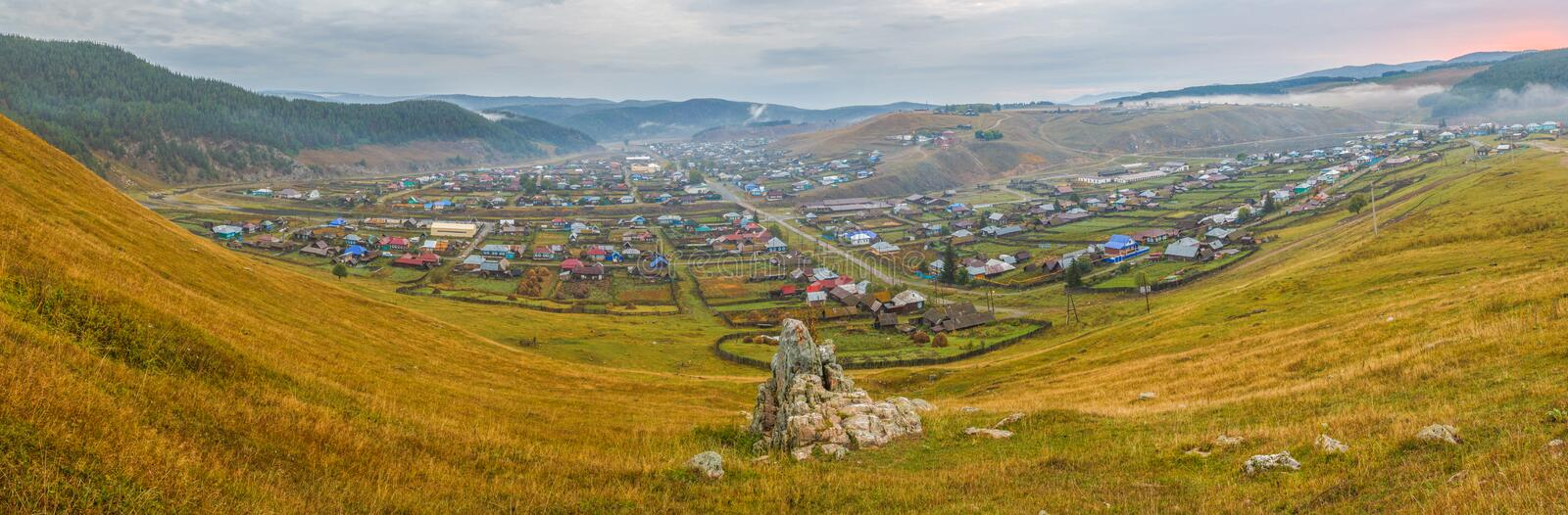 Ural village in the mountains. Kaga. Bashkortostan. Picturesque Ural valley. The village in the mountains. Kaga. Bashkortostan royalty free stock photography