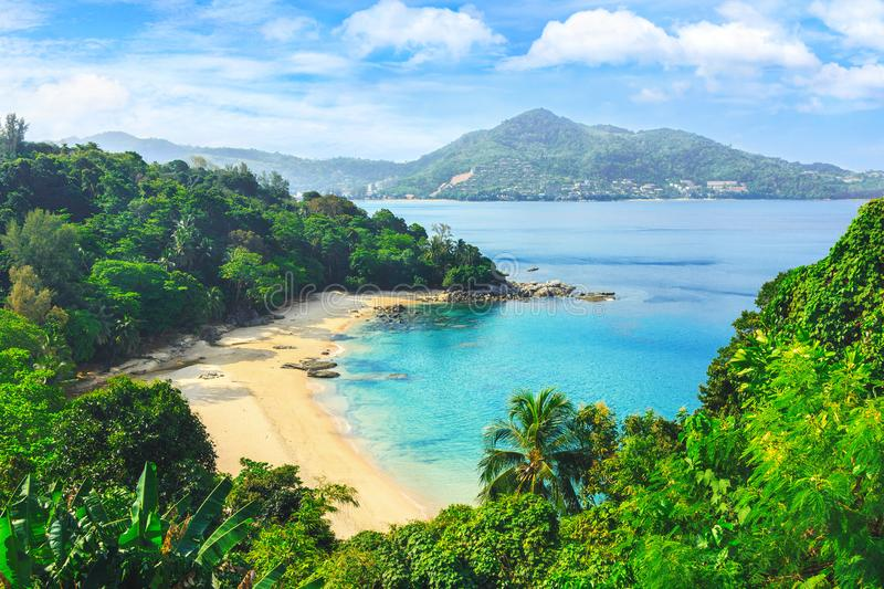 Picturesque view of Andaman sea in Phuket island, Thailand. View through the jungle on the beautiful bay and mountains. Tropical beach Laem Singh stock image