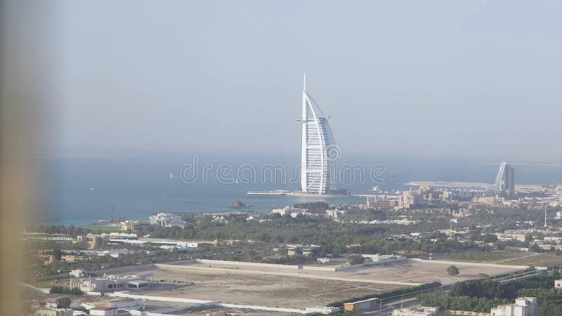 Picturesque view of Dubai city and blue from the window of a hotel room. Stock. Stunning view of the Burj Al Arab luxury stock photos