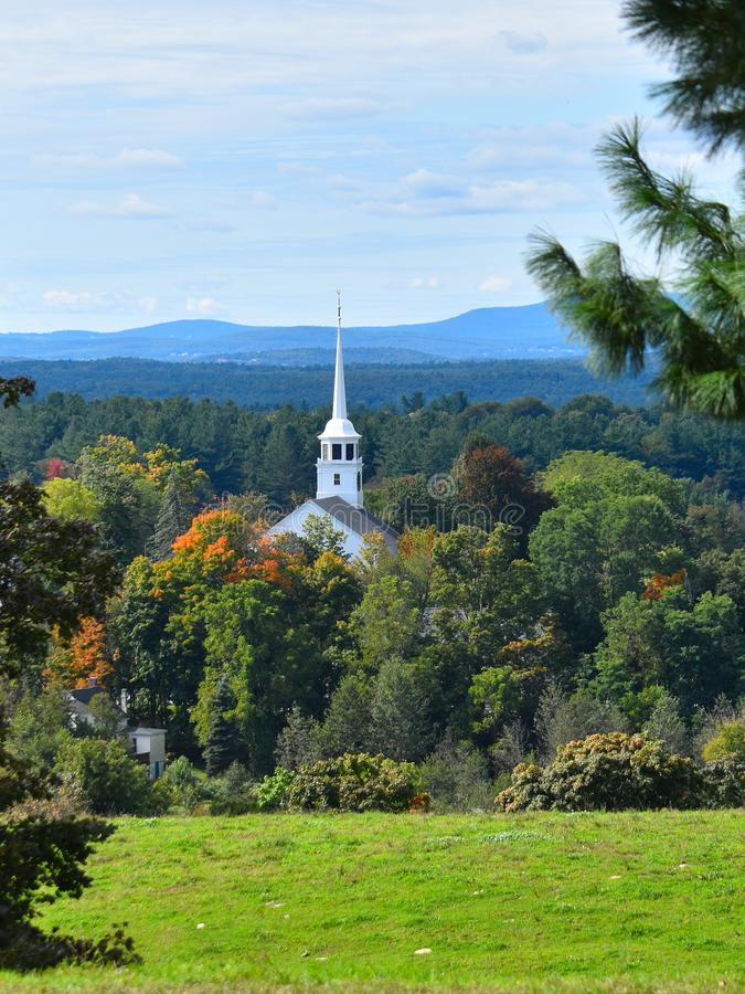 Old Church and steeple on a partly cloudy Fall day in Groton, Massachusetts, Middlesex County, United States. New England Fall. Picturesque view of a New royalty free stock photo