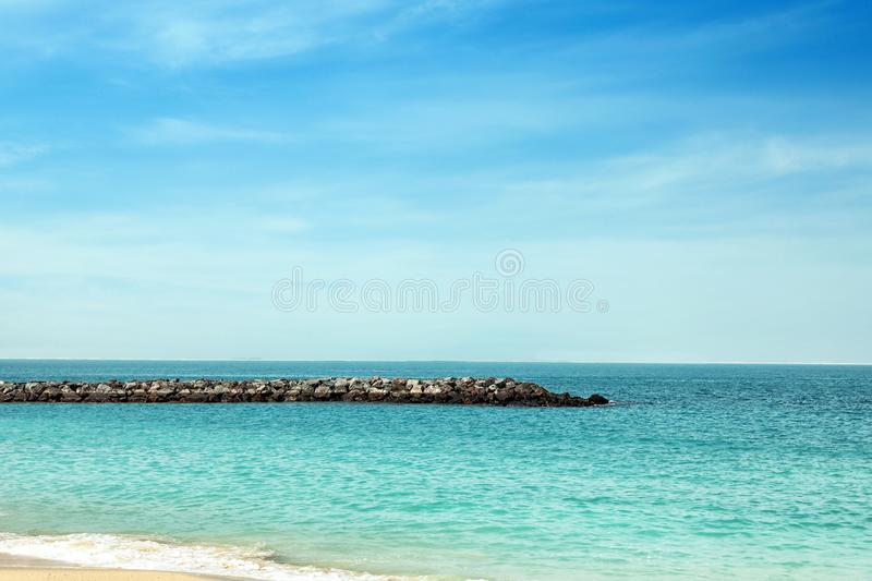 Picturesque view of ocean with rock breakwater stock photos