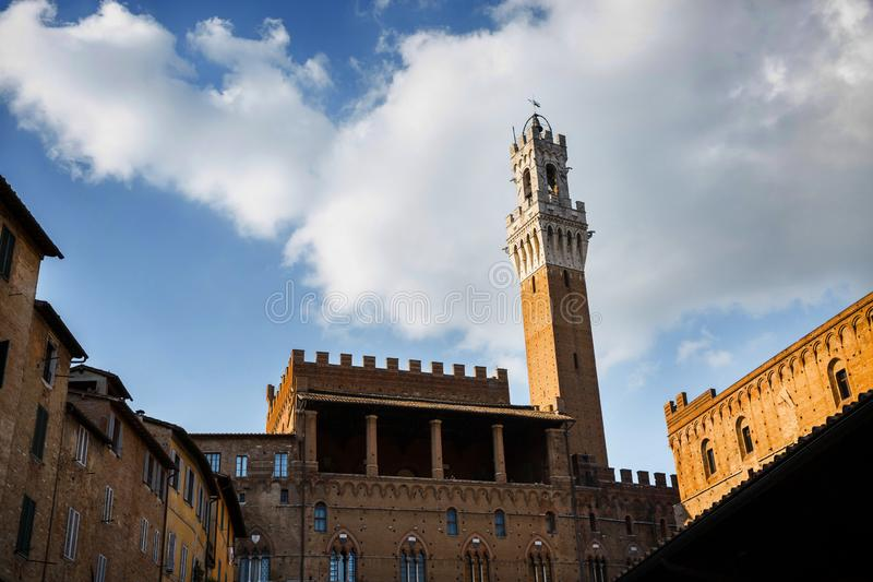 Picturesque view of Palazzo Publico and Torre del Mangia (Mangia tower) in Siena, Tuscany, Italy. Scenic travel destination royalty free stock photos