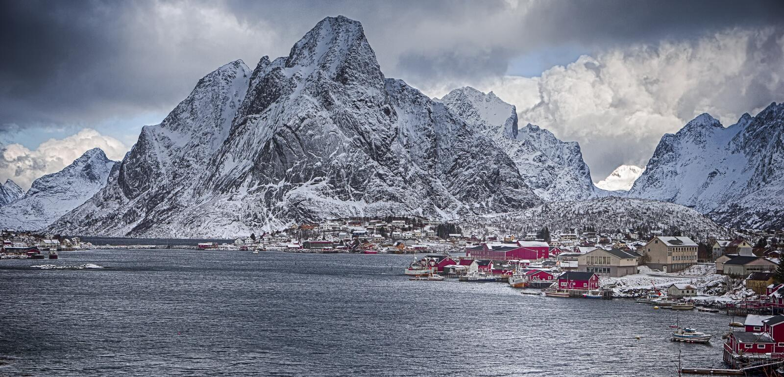 Picturesque View of Reine Villlage on Lofoten Island Over the Polar Circle. Travel Concept and Ideas. Picturesque View of Reine Villlage on Lofoten Island Over royalty free stock image