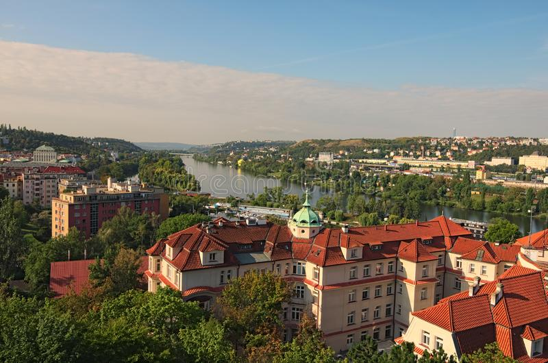 A picturesque view of residential buildings near the Vltava river. Summer landscape photo on a sunny morning. stock image