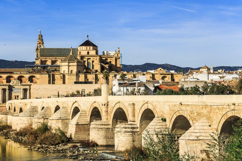 Picturesque view of the Roman bridge of Cordoba facing Mosque-Cathedral of Cordoba stock image