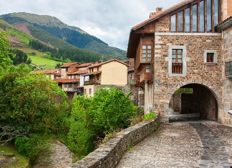 Picturesque view on street with old houses in Potes, Cantabria, Spain.  stock photo