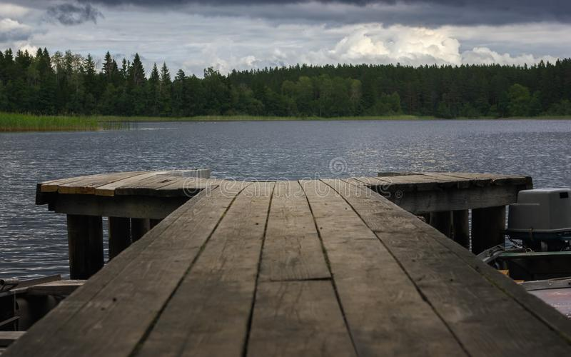 View Of The Forest Lake From A Wooden Pier stock image