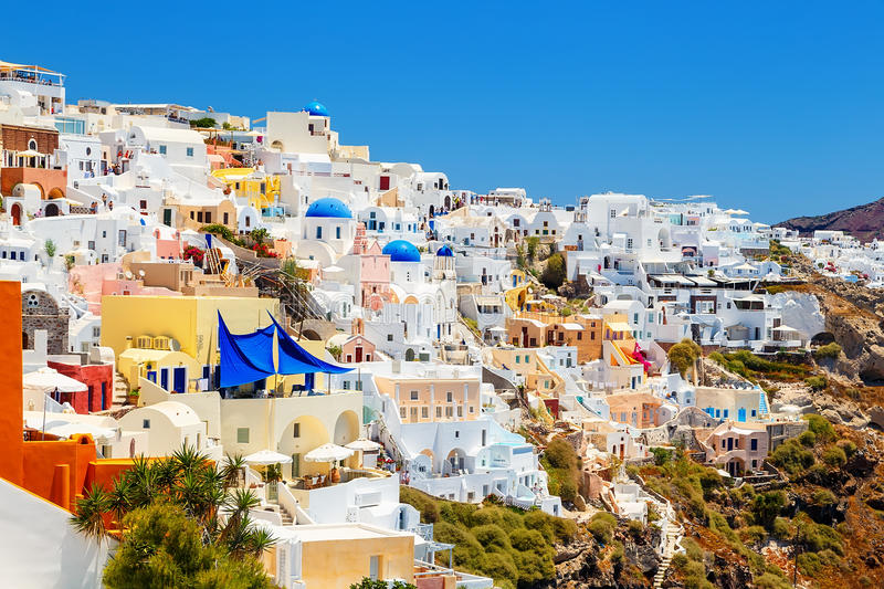 Picturesque village and the rest in the traditional white houses in Oia, Santorini, Greece royalty free stock photos