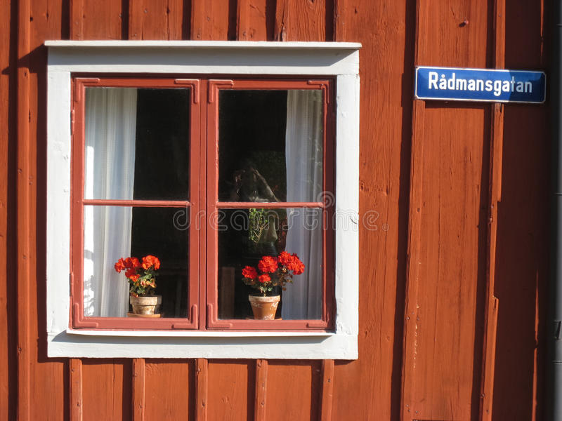 Picturesque window with flowers. Linkoping. Sweden. A picturesque window with flowers in radmansgatan. Old linkoping. Sweden royalty free stock photography