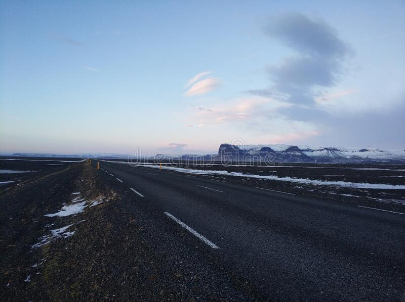 Picturesque winter landscape of Iceland. The perfect road to perspective.  stock images